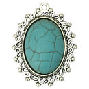 Silver Oval Turquoise Pendant with Swirl and Bead Accents in Pewter